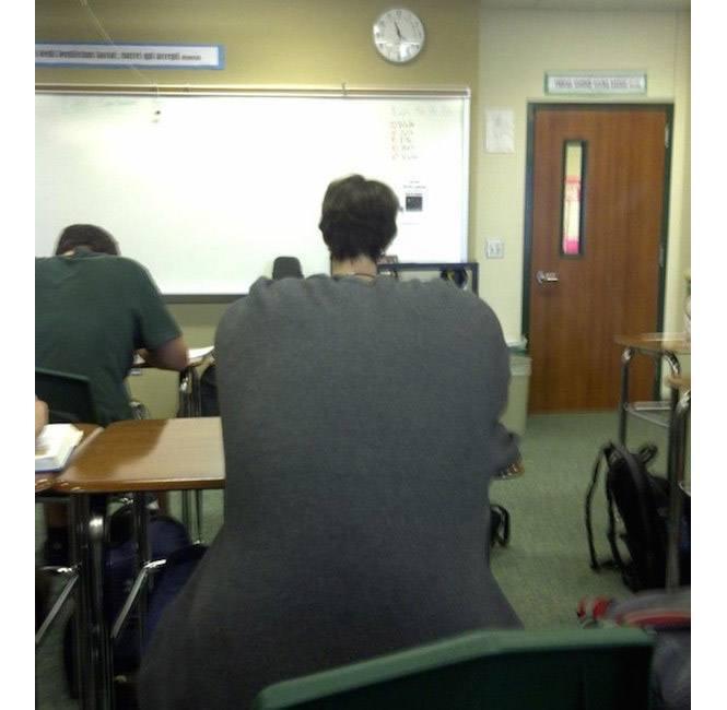 Student s velkými zády